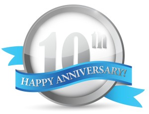 10th anniversary seal and ribbon illustration design over white